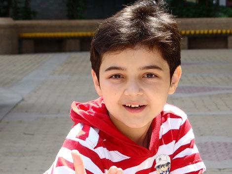 七岁的维吾尔族小男孩阿尔法也是他们中的一位
